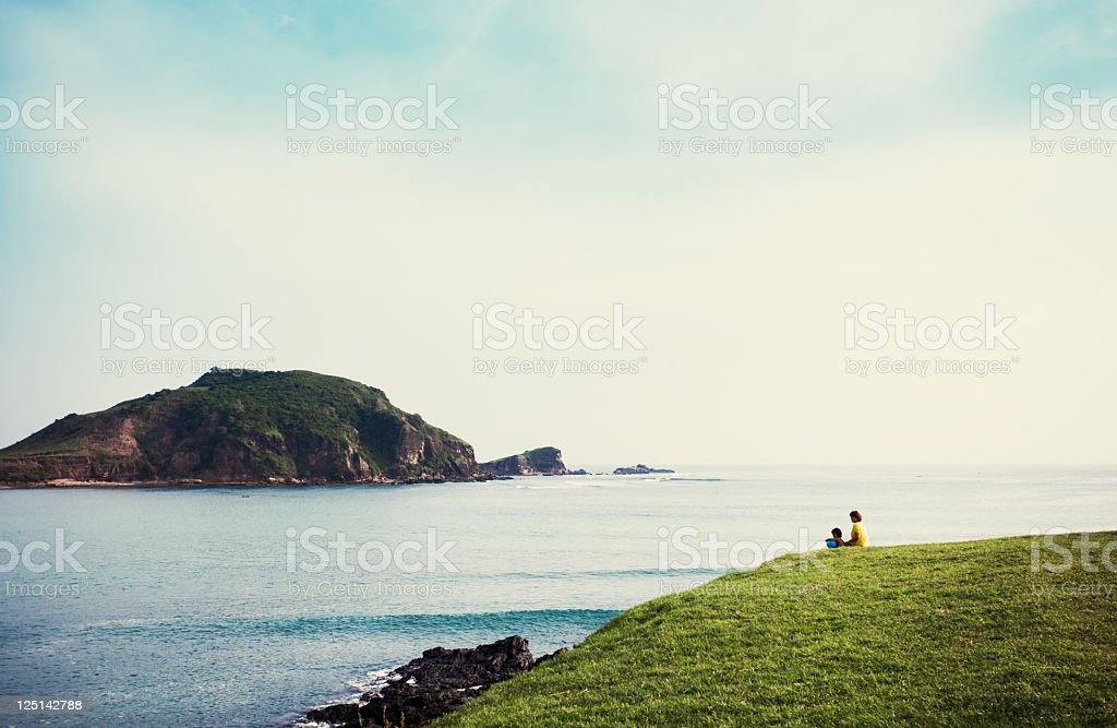 family by ocean stock photo