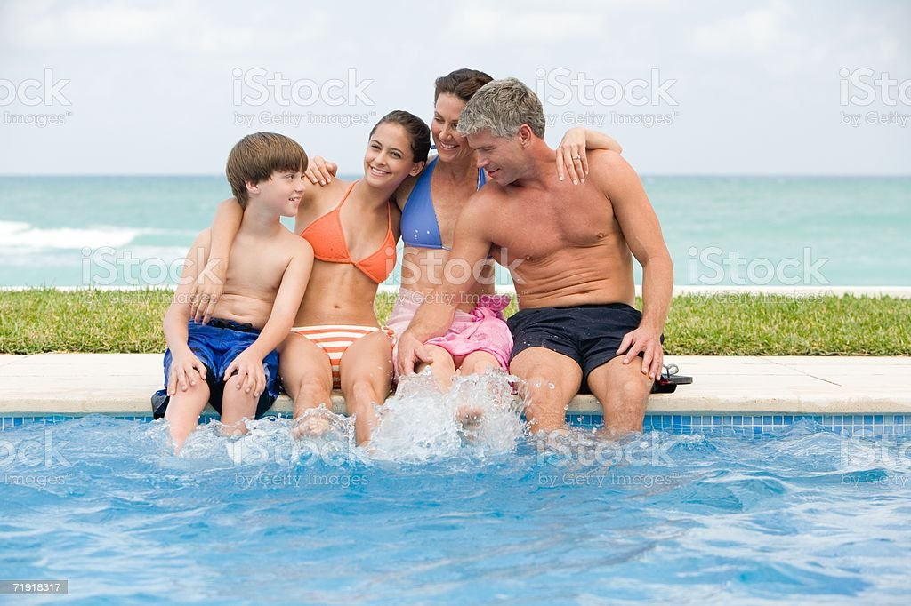 Family by the pool stock photo