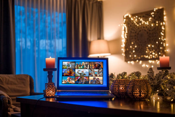 Family calling on a Home Office Set Up for Webinar and Teleconference at Christmas stock photo