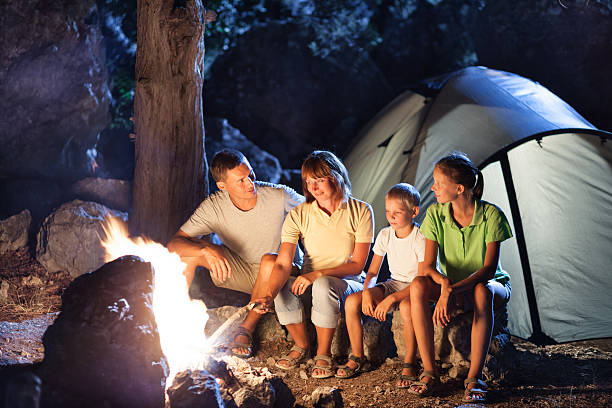 Family camping at night stock photo