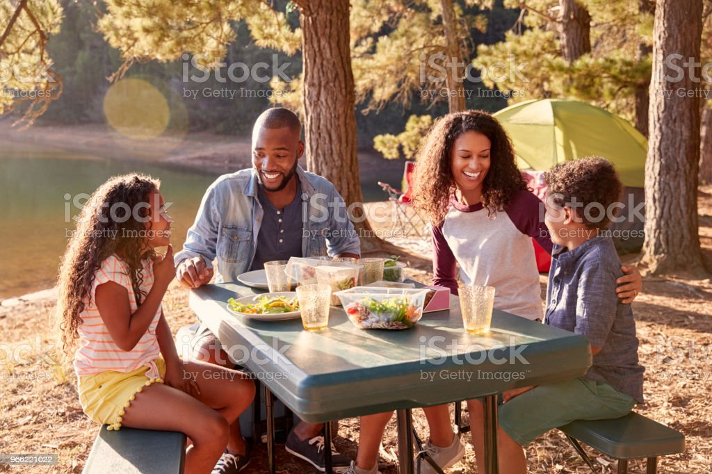 Family Camping By Lake On Hiking Adventure In Forest - Royalty-free 10-11 Years Stock Photo