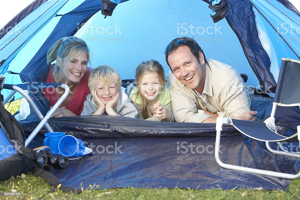 Family camping in tent royalty-free stock photo
