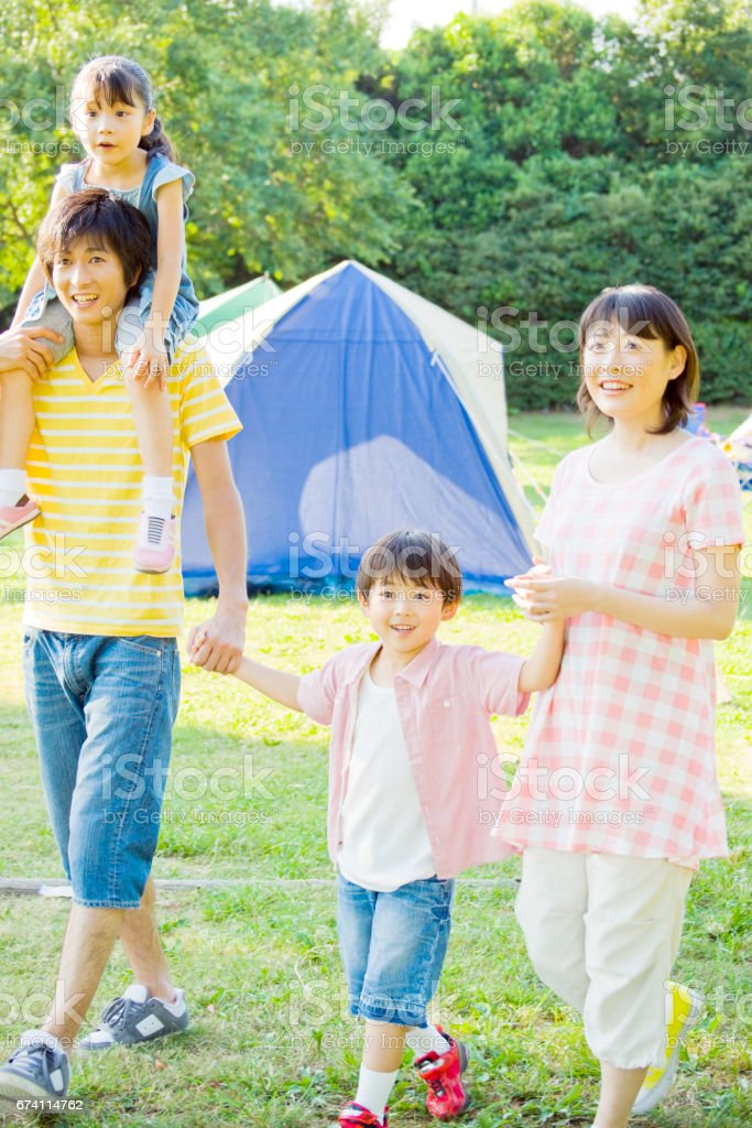Family camping spot and walk hand in hand royalty-free stock photo