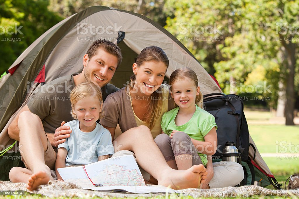 A family camping together in the park  royalty-free stock photo
