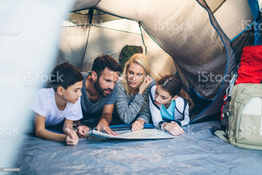 Family camping together stock photo