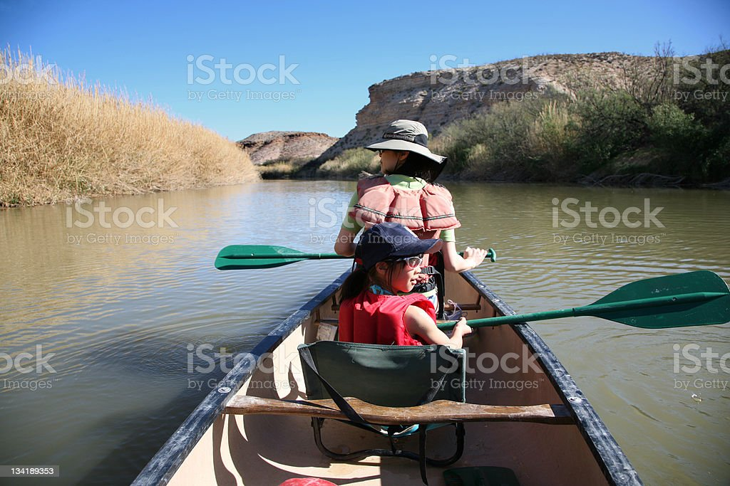 Family Canoeing in River royalty-free stock photo