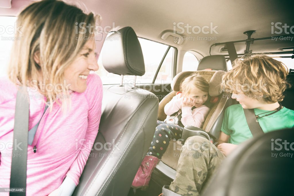 Family car safety with children safely strapped in stock photo
