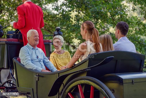 istock Family carriage ride 501572830