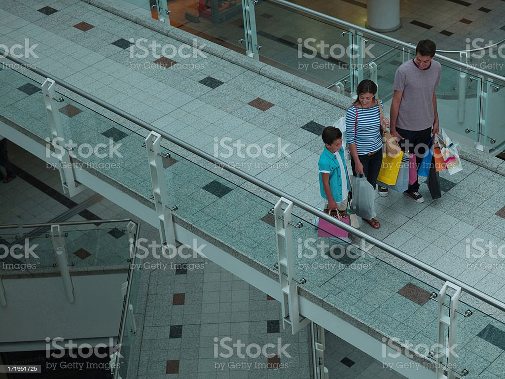 Family carrying shopping bags in mall royalty-free stock photo