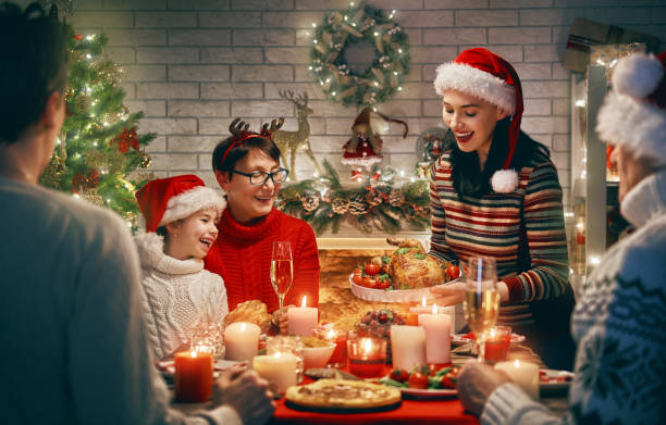 family celebrates christmas. - family dinner stock photos and pictures
