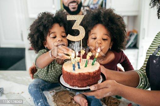 istock Family celebrating 3d  birthday 1130128053