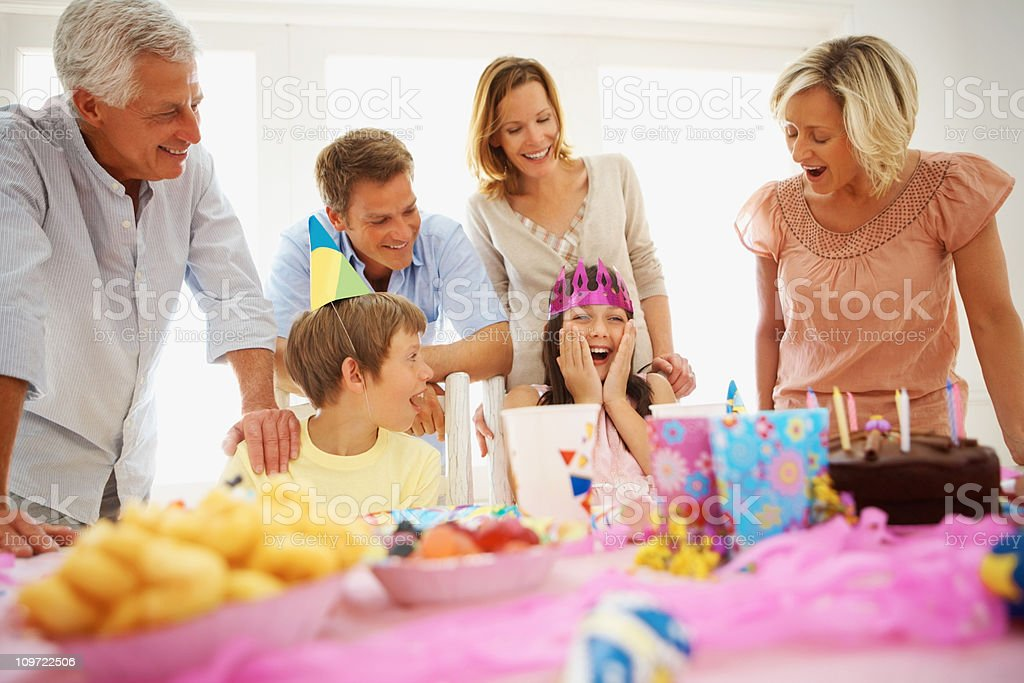 Family celebrating a birthday party royalty-free stock photo