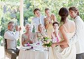 istock Family celebrating at wedding reception 102283928