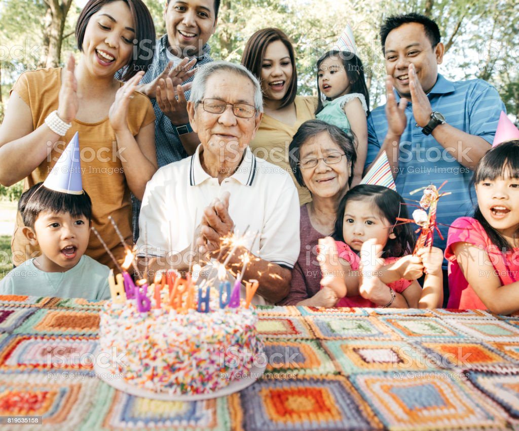 Family celebrating birthday together stock photo