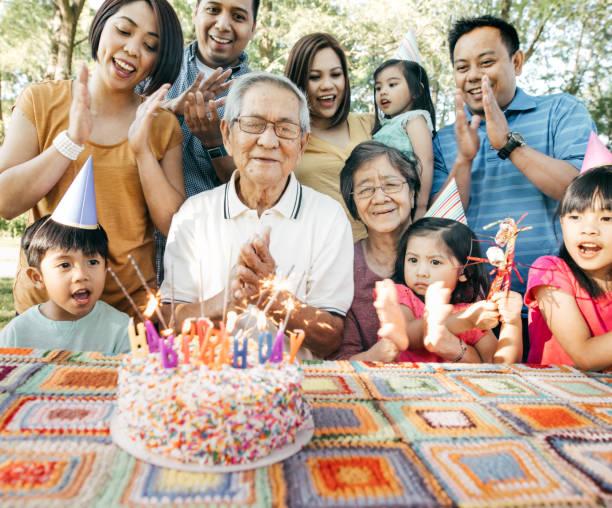 Family celebrating birthday together stock photo