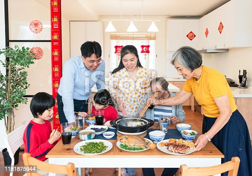 A Taiwanese family enjoying a traditional meal to celebrate Chinese New Year together.
