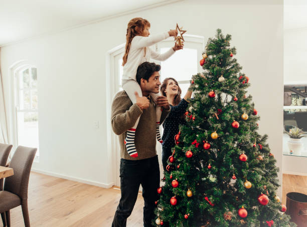 Family celebrating Christmas at home. stock photo