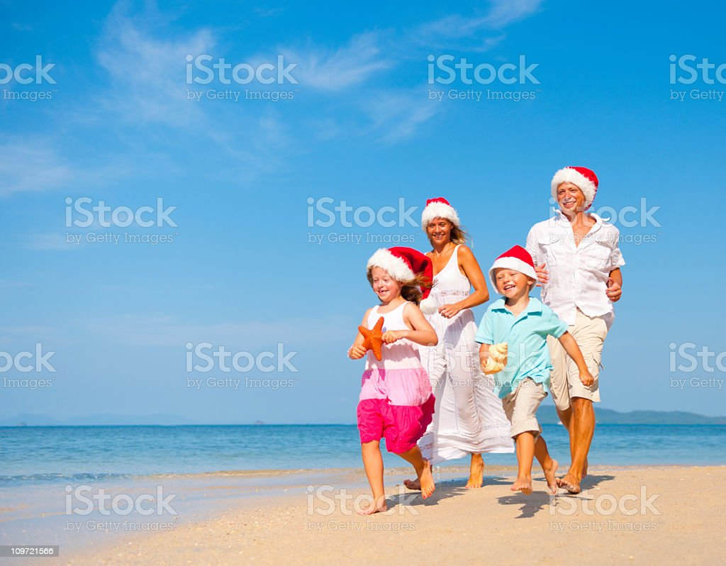 Family Celebrating Christmas on  the Beach royalty-free stock photo