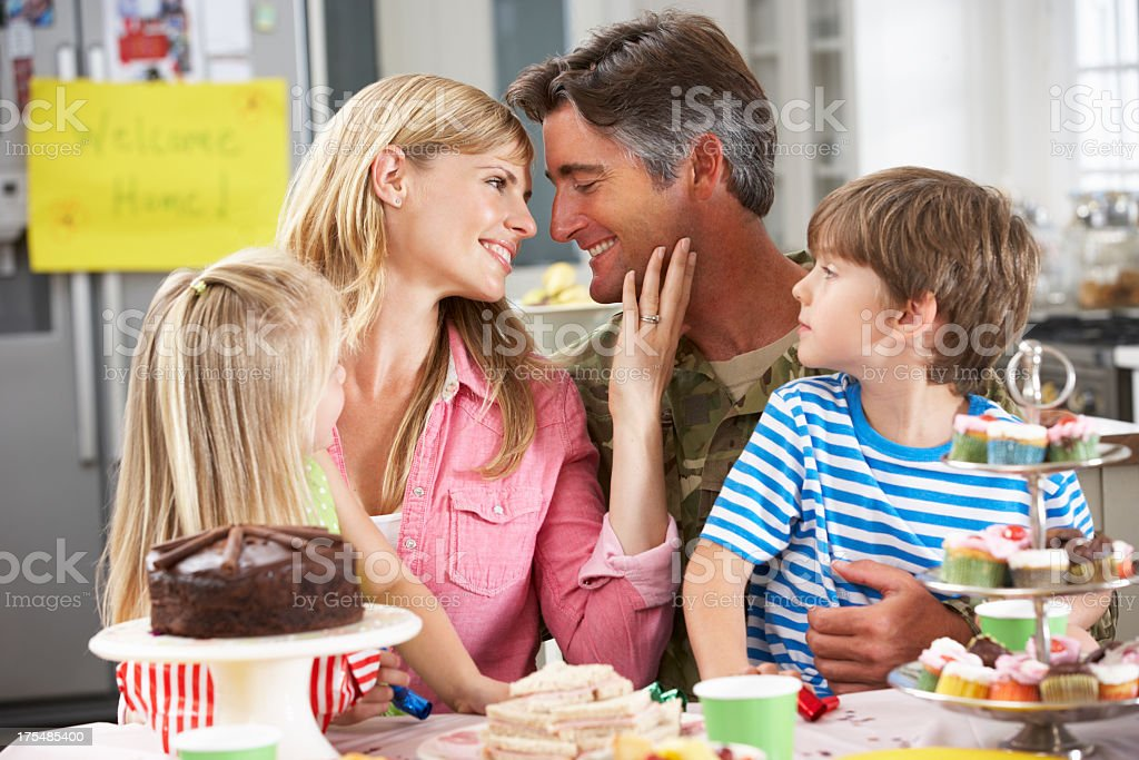 Family Celebrating Father's Homecoming stock photo
