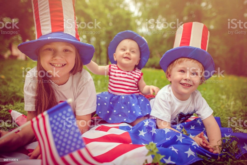 Family celebrating Fourth of July stock photo