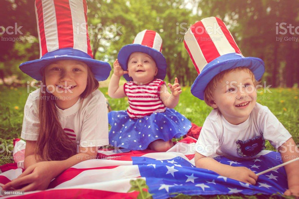 Family celebrating Fourth of July stock photo