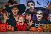 istock family celebrating Halloween 1036194192