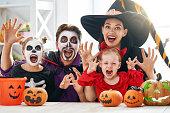 istock family celebrating Halloween 1036194398
