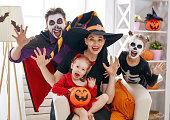 istock family celebrating Halloween 1036194566