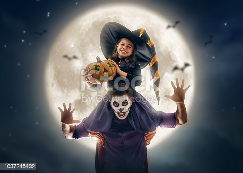 istock family celebrating Halloween 1037245432