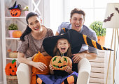 istock family celebrating Halloween 1041752636