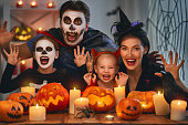 istock family celebrating Halloween 1042553342
