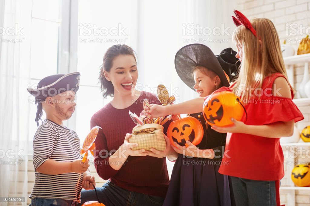 family celebrating Halloween stock photo