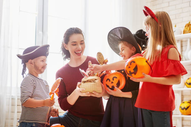 family celebrating Halloween stock photo