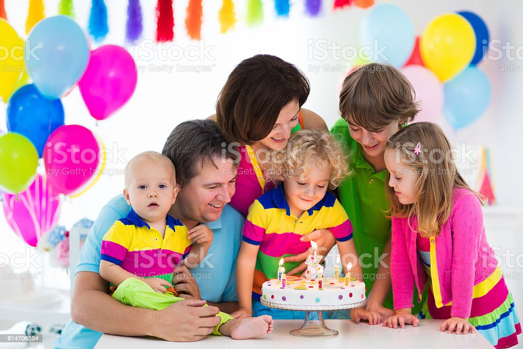 Family celebrating kids birthday stock photo