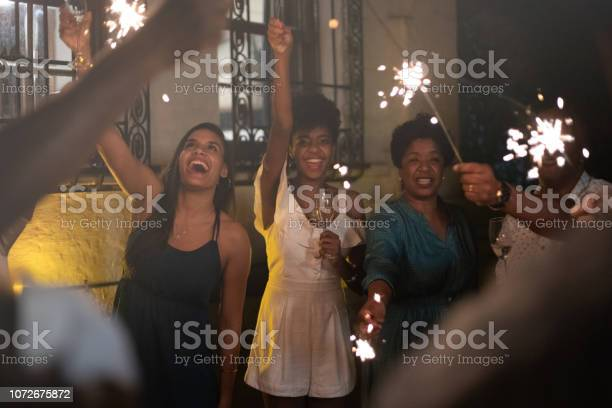 Family  Celebrating New Year Party with Sparkler