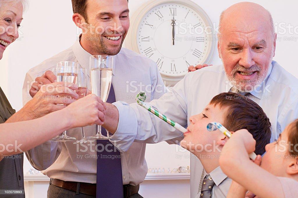 Family celebrating New Year royalty-free stock photo