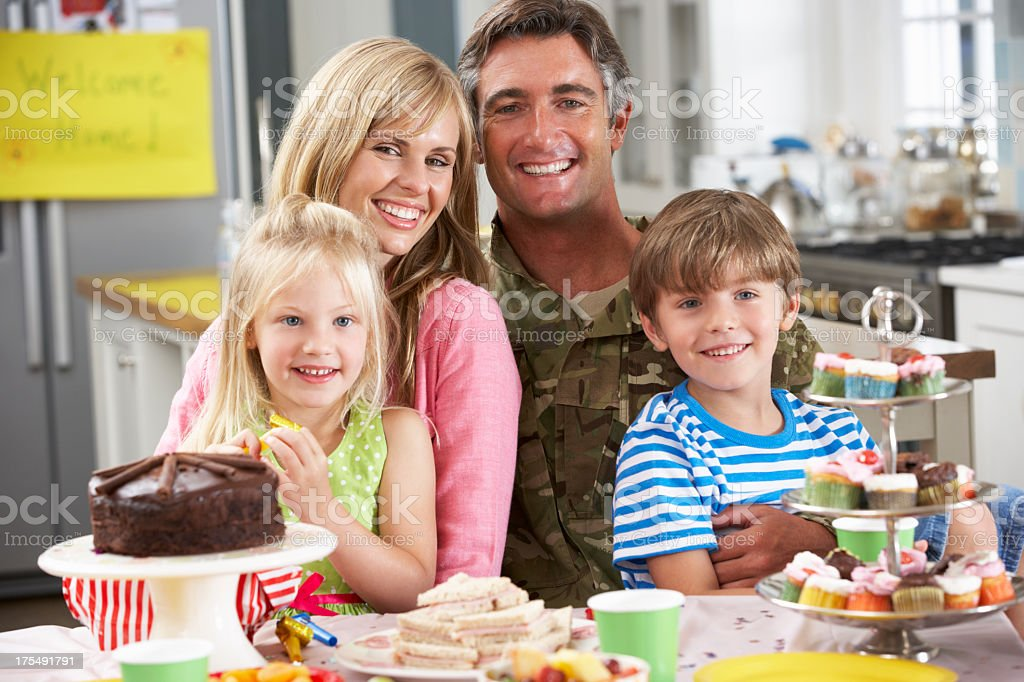 Family Celebrating Soldier Father's Homecoming stock photo