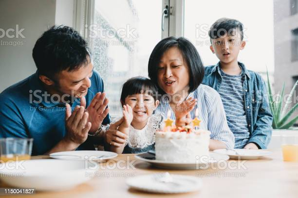 Family Celebrating The Birthday Of The Little Daughter Together Stock Photo - Download Image Now