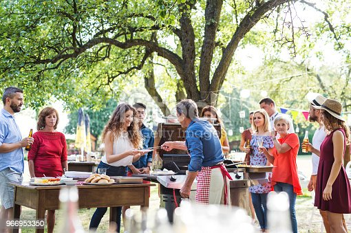 istock Family celebration or a barbecue party outside in the backyard. 966953350