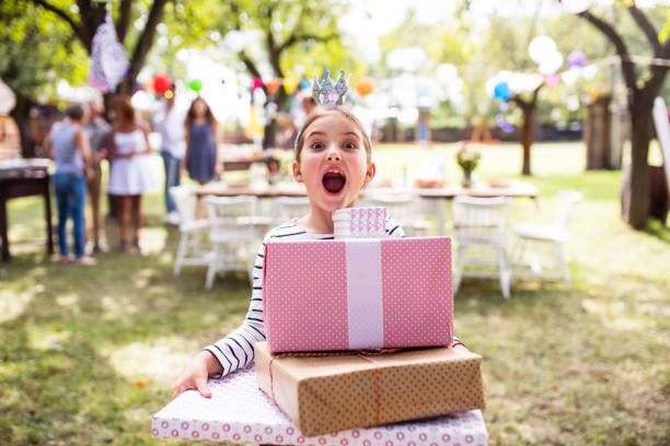 family celebration or a garden party outside in the backyard. - birthday gift stock photos and pictures