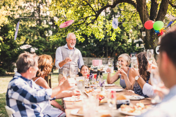 family celebration or a garden party outside in the backyard. - party social event stock pictures, royalty-free photos & images