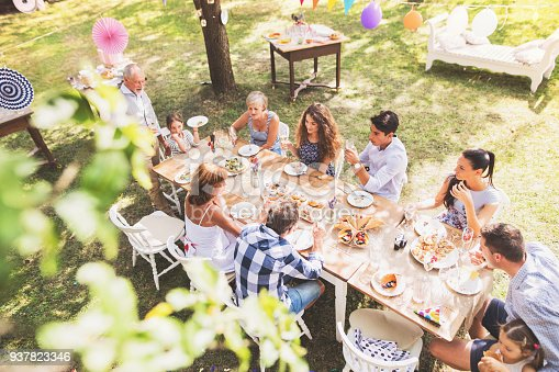 istock Family celebration or a garden party outside in the backyard. 937823346