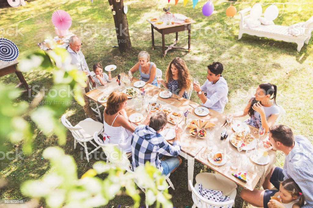 Family celebration or a garden party outside in the backyard. stock photo