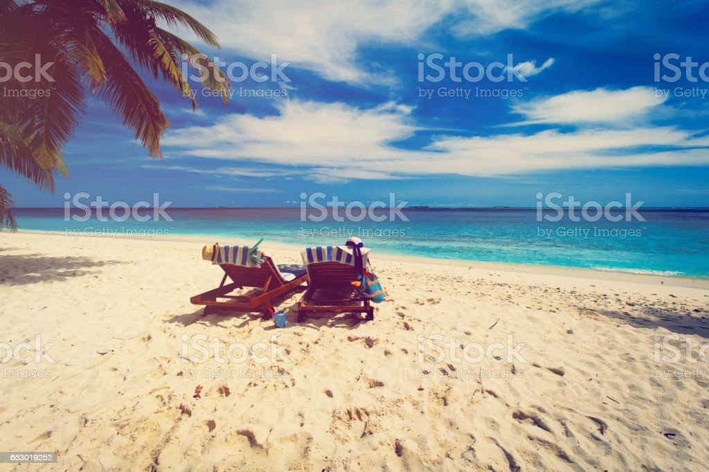 family chairs on the tropical beach stock photo