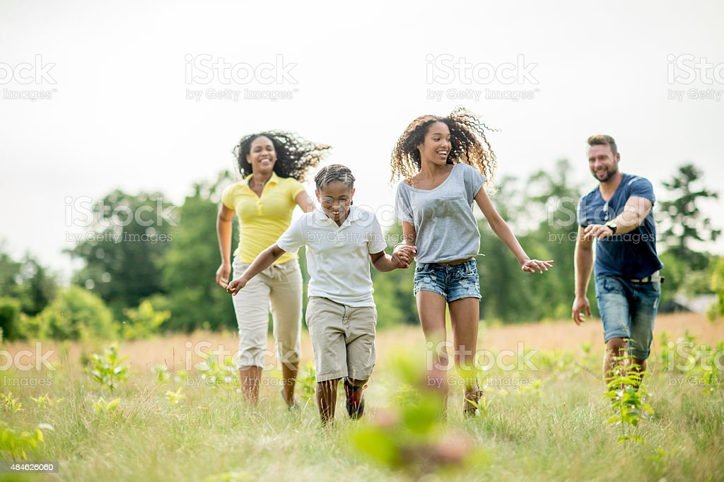 Family Chasing Each Other stock photo