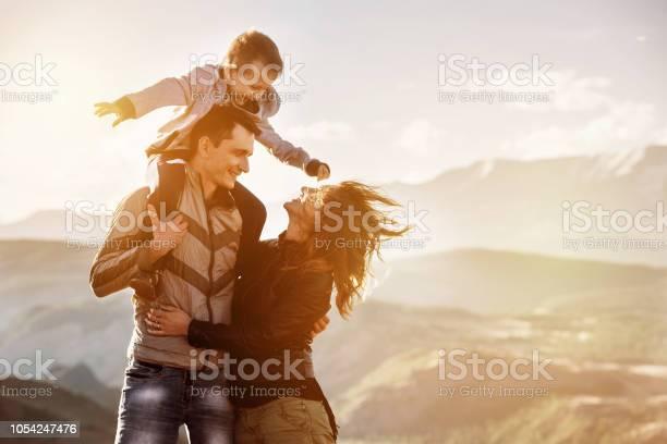 Photo of Family child walking mountains sunset