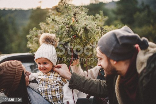 Family choosing a Christmas tree together