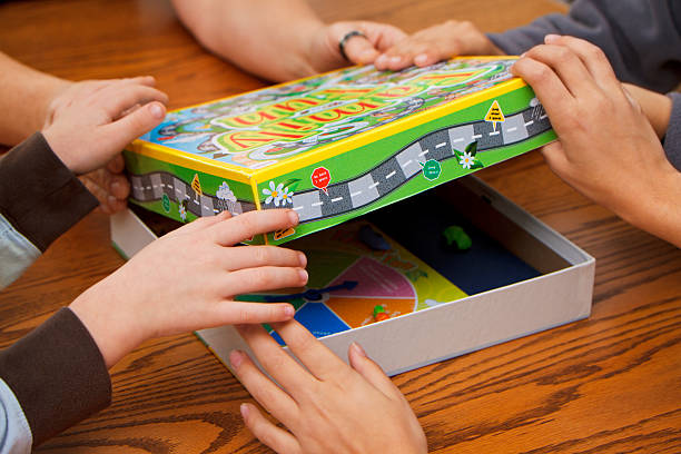 Family Choosing Board Games To Play stock photo