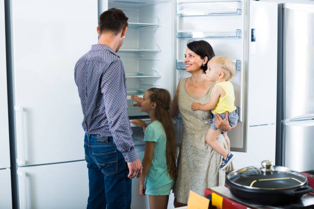 family choosing new freezer in store - happy person buy appliances stock photos and pictures