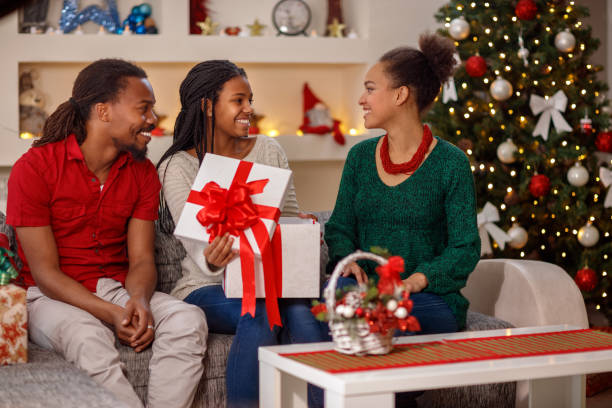 family christmas holidays concept exchanging christmas gifts stock photo